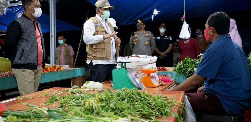 Bupati Siak Alfedri bersama Kapolres Siak, melaksanakan Penerapan pelaksanaan PPKM di Kecamatan Tualang